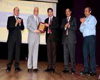 Hon'ble Vice Chancellor, AUMP Lt Gen V K Sharma, AVSM (Retd.) presenting the Memento to Dr. J Girish, Vice President, RBEF (Amity)