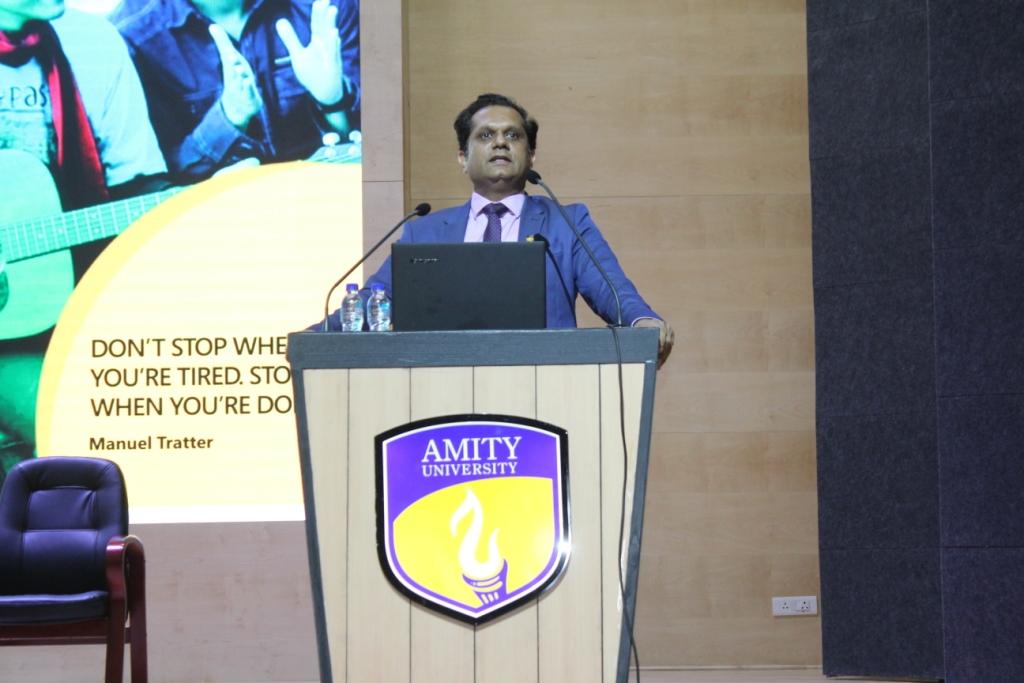 Prof (Dr) Vikas Madhukar, Director Admission Amity University Gurugram addressing new students