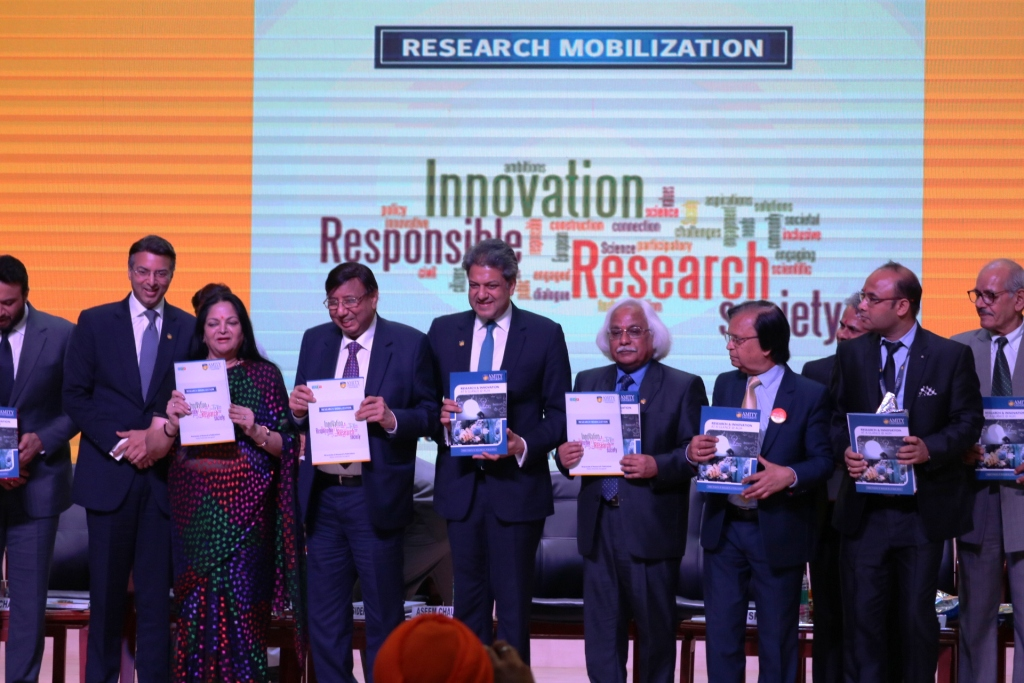 Amity dignitaries releasing Research & Innovation booklet