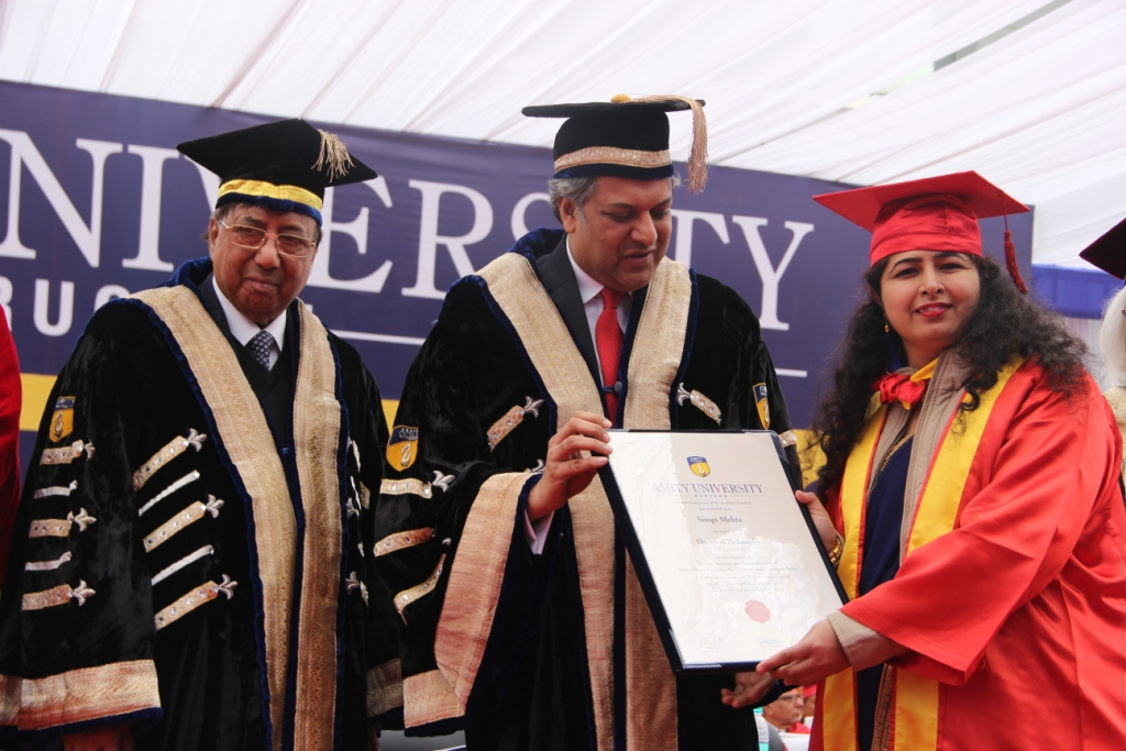 Graduates receiving degree from Honorable Founder President, Amity Education Group Dr Ashok K Chauhan and Chancellor Amity University Gurugram, Dr Aseem K Chauhan