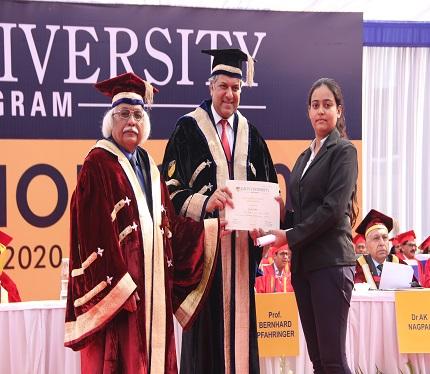 Graduate receiving degree from Dr Aseem Chauhan, Chancellor, Amity University Gurugram