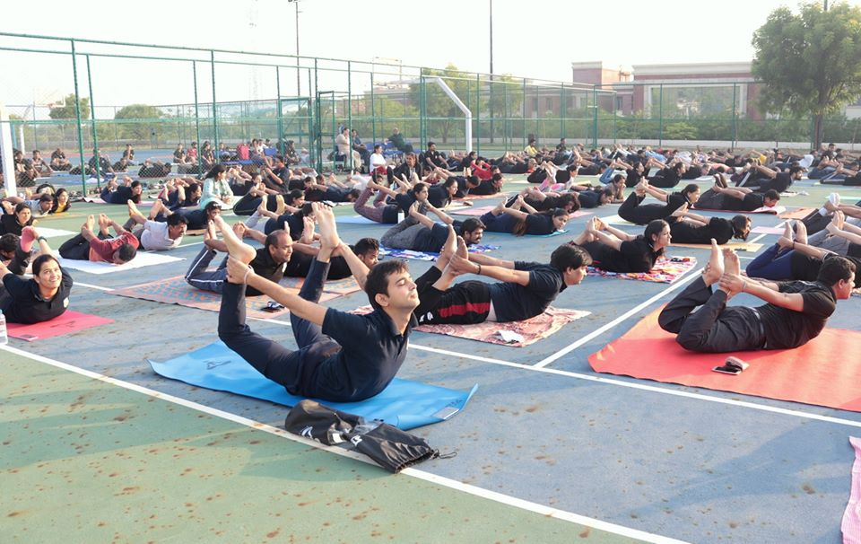Faculties of AUMP practicing yoga
