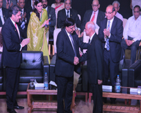 The Hon'ble Founder President congratulating the Hon'ble Vice Chancellor, AUMP on the 5th Raising Day of the University