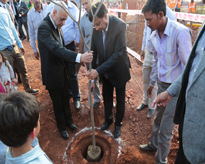 The Hon'ble Founder President Sir planting a tree