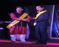 Mr Fresher 2014 congratulating Mr Fresher 2015