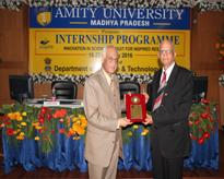 Lt. Gen V K Sharma AVSM (Retd) Hon'ble Vice Chancellor, AUMP presenting the memento to Prof (Dr) S P Bajpai, Dean Research