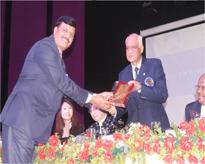 Prof.(Dr.) Rajesh Singh Tomar, Organising Secretary, Int-BIONANO-2016, felicitating Lt. Gen. V.K. Sharma AVSM (Retd.), Vice Chancellor, Amity University, Gwalior.